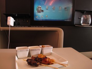 The appetizer. Now whose bright idea was it to serve chicken satay, on a LONG POINTY STICK? Forget hijacking concerns. Hit turbulence, and you're missing an eye, buddy.