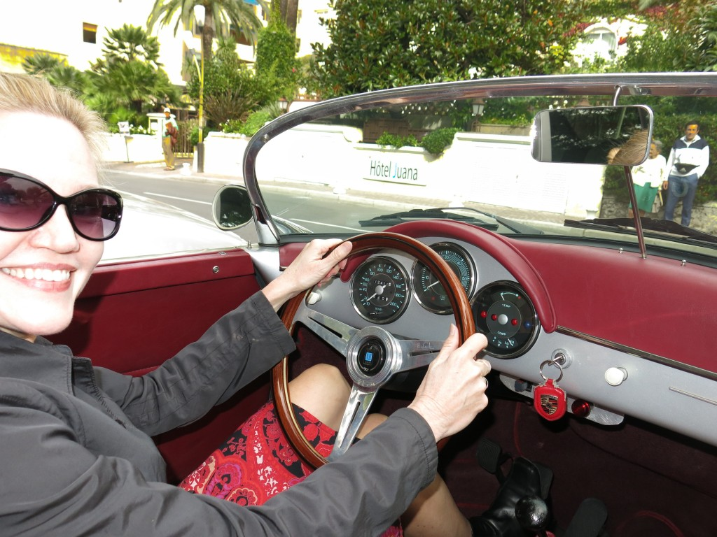 blonde woman driving vintage 1956 Porsche 356 Speedster convertible