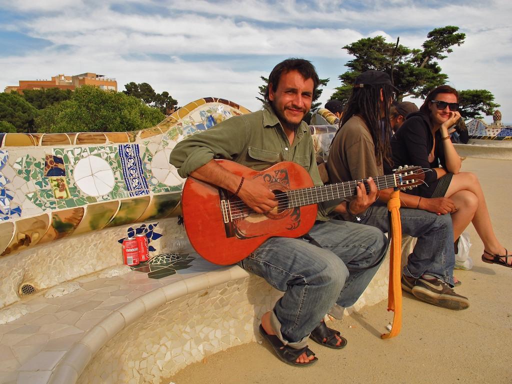 A guitarist serenades visitors at Gaudi's Park Guell in Barcelona.