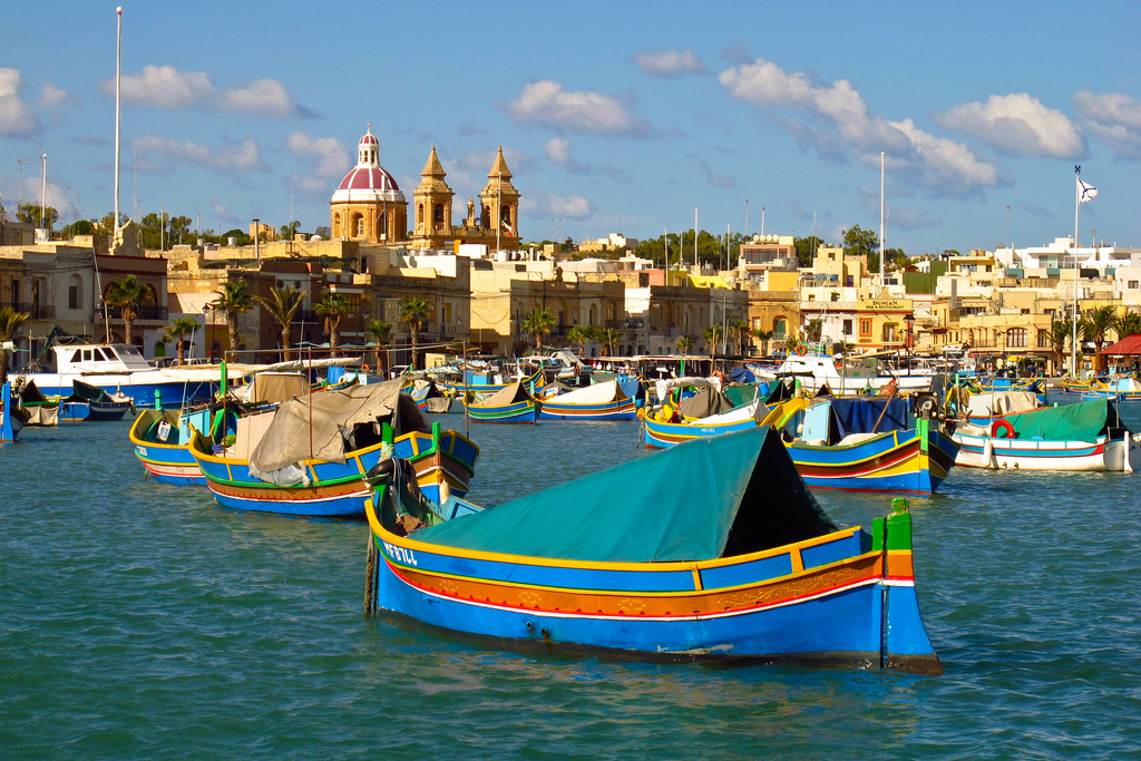 Traditional Maltese boats bob in the harbor of Marsaxlokk.