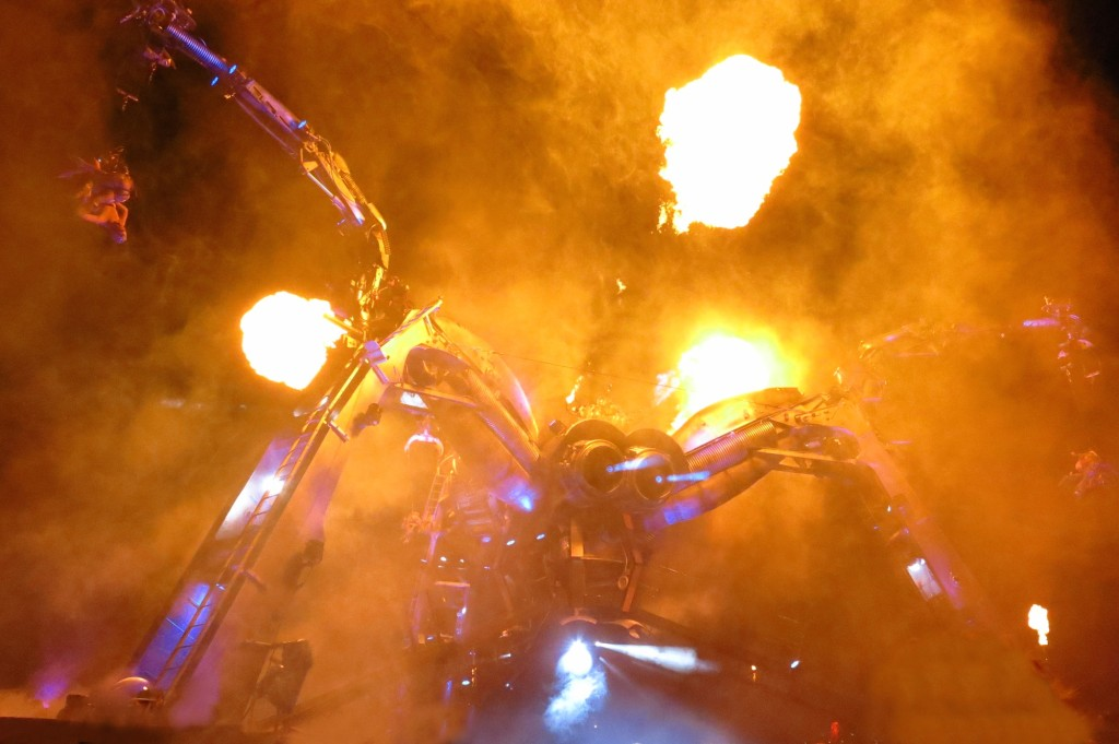Arcadia's metal monster comes equipped with lasers--and flame throwers. It also plays some killer music (not literally, all appearances aside).