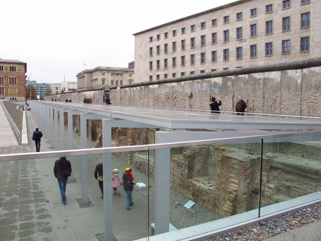 The Topography of Terror Museum. At ground level, you see a remnant of the former wall. Below are former Gestapo cells.