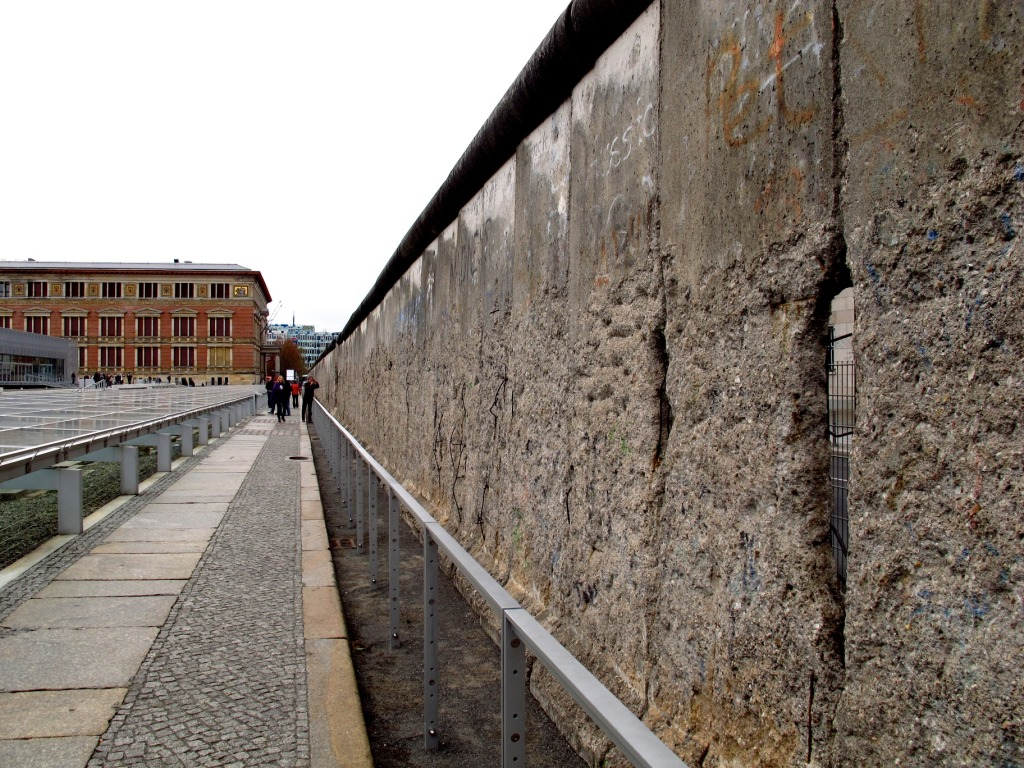 "One guide says that if you were to put all the chunks of concrete that have been sold as ""part of the Berlin Wall"" back together, you could rebuild it three times over. Let's hope that never happens."