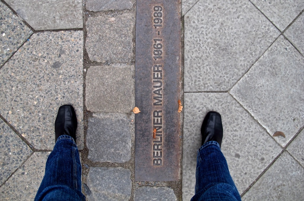 The site of the former Berlin Wall, one foot in the East and one in the West.