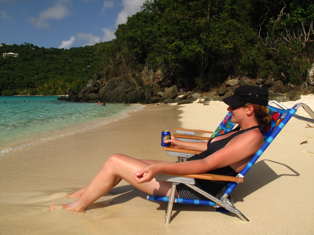sunbather on Hawksnest Beach, St. John