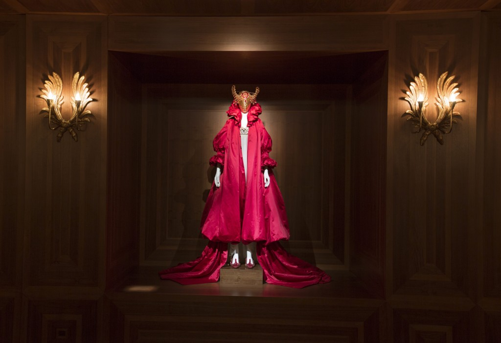 "A matador-like figure in a red robe and jeweled bull mask presides over the Romantic Nationalism gallery at the ""Alexander McQueen: Savage Beauty"" exhibit at London's V&A."