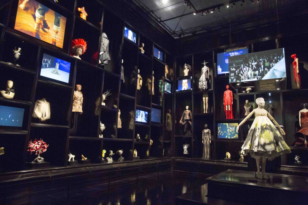Catwalk footage from Alexander McQueen's shows plays in the Cabinet of Curiosities, which houses 120 garments and accessories.