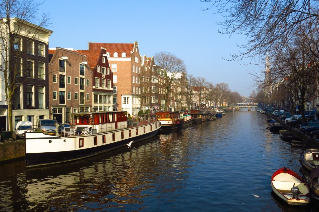 Horizontal image of Prinsengracht Canal in Amsterdam with boats on a sunny day