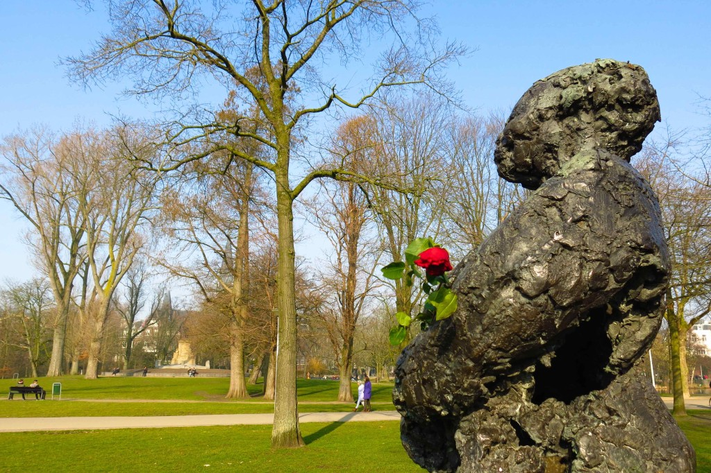 A statue bears roses in Amsterdam's Vondelpark, a sprawling green expanse in the western party of the city
