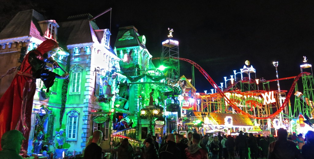 neon-lit roller coasters at Winter Wonderland Christmas market in London, England's Hyde Park