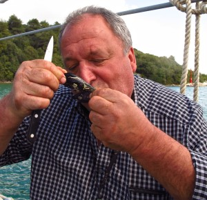 Bozidar Sare, owner of Bota Sare, enjoys a mussel in its shell