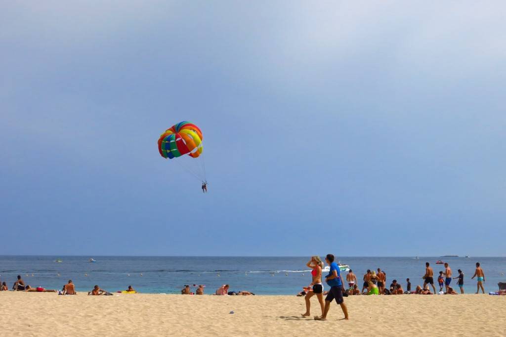 Two parasailers float over the water just off the beach at Magaluf on the Spanish island of Majorca.