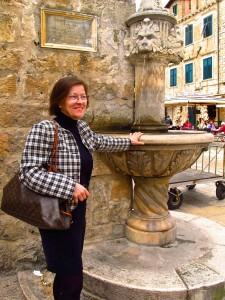 Tea Batinic lived in Dubrovnik and remained while it was under attacked during the war in the 1990s. She was watching the scene from the window when this fountain in the Morning Market was struck. LIke the rest of the city, it has now been restored to its former glory.