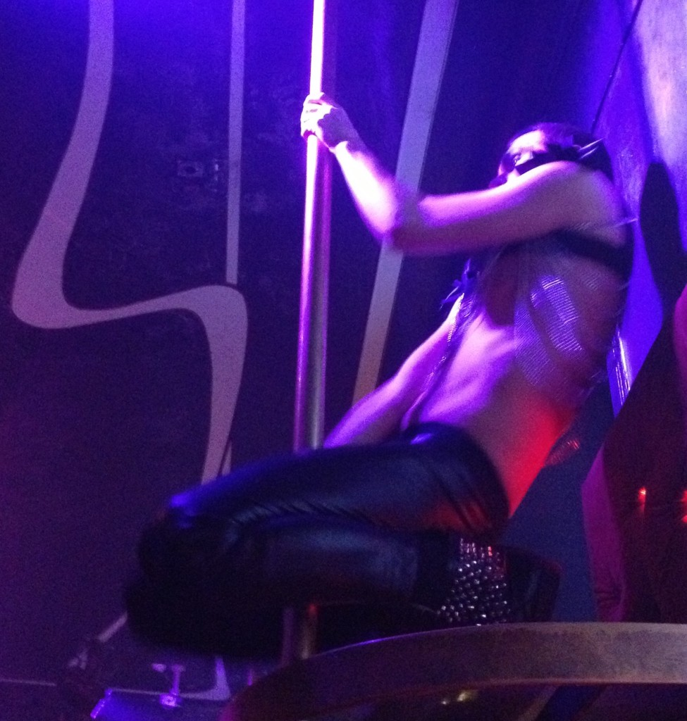 Leather-clad pole dancer at Club Prive in Tallinn, Estonia