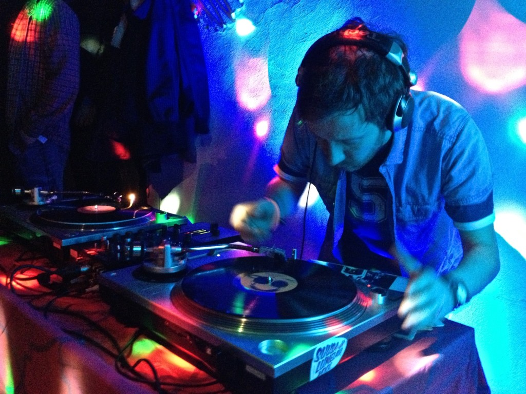 A DJ spins tunes at Must Puudel (Black Poodle), a retro bar in Tallinn's Old Town. Copyright Amy Laughinghouse.
