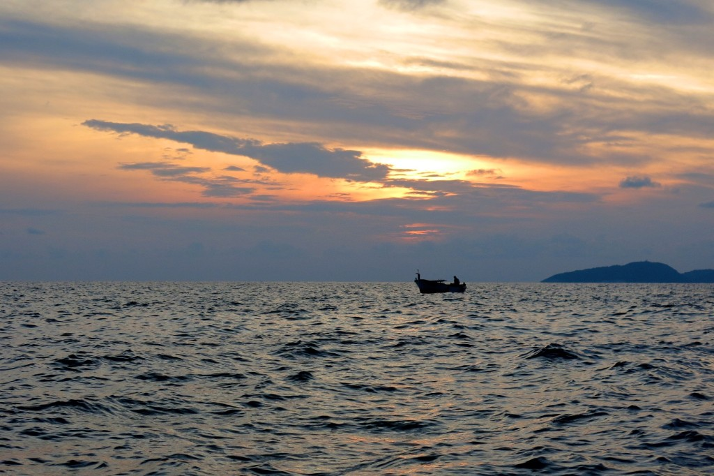 Boat at sunset off the coast of Dubrovnik, Croatia