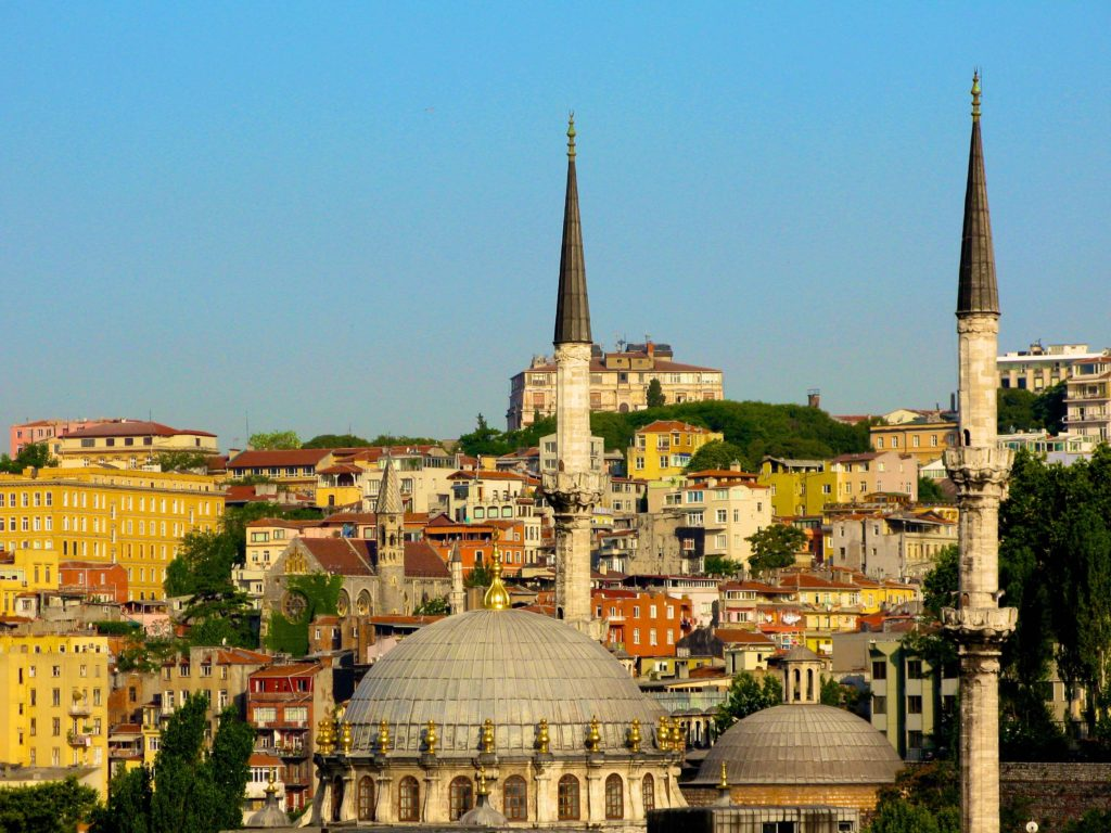 Minarets dot Istanbul's skyline on a blue sky day