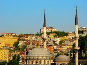 Minarets dot Istanbul's skyline on a blue sky day