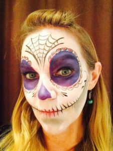 woman with Day of the Dead face painting