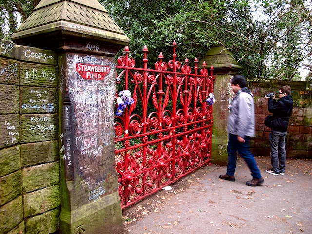 On Liverpool's Magical Mystery Tour, visitors have an opportunity to exit the bus and take a photo at the gates of Strawberry Field. John Lennon used to climb a tree in his aunt's backyard to peer over the fence at this former boys' home. Photo copyright Amy Laughinghouse.
