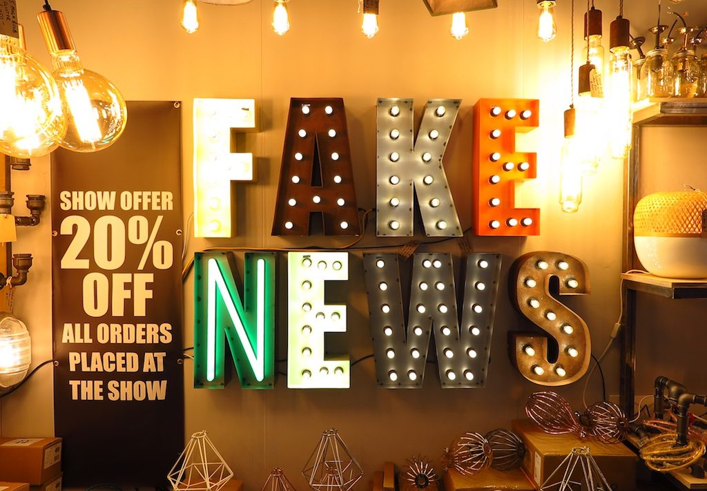 "Just what Donald Trump needs for the Oval Office: a ""Fake News"" light fixture from JamJar Lights."