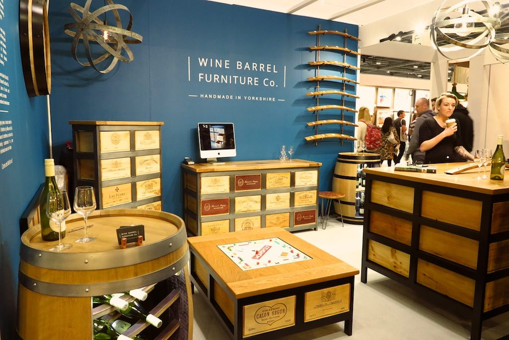 furniture made out of wine barrels and wooden wine cases