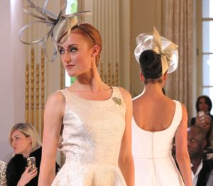women in champagne-colored fascinators at Isabell Kristensen's 2017 Royal Ascot Couture Collection runway show
