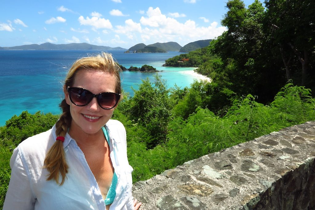 woman poses at overlook with Trunk Bay, St. John in the background. Copyright Amy Laughinghouse