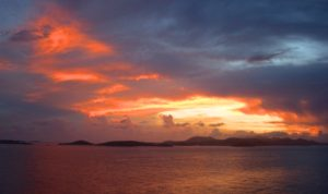 fiery sunset over the Virgin Islands. Copyright Amy Laughinghouse.