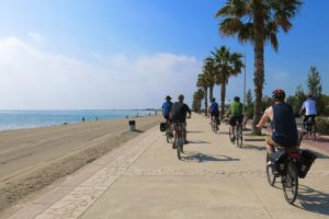 Cyclists enjoy a pancake-flat path along the beach in Ampolla, Catalunya, Spain. Copyright Amy Laughinghouse