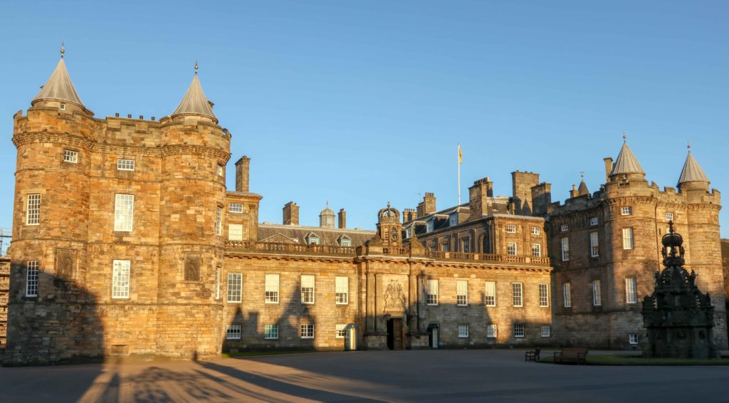 Golden afternoon sunshine illuminates the Palace of Holyroodhouse in Edinburgh. Copyright Amy Laughinghouse