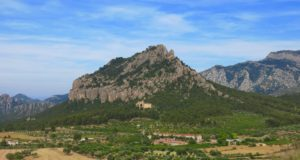 Horta de Sant Joan overlooks the rugged Magic Mountain. A church built by the Knights Templar and the Monastery of Saint Salvador, who is said to have performed miracles here, sit at its base. copyright Amy Laughinghouse