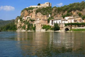 Miravet in Catalunya, Spain towers above the Ebro River, which has flooded the village several times over the past few centuries. It's crowned by a castle once occupied by the Knights Templar. Copyright Amy Laughinghouse