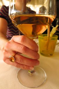 woman holding glass of rose wine. Copyright Amy Laughinghouse
