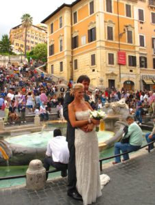 a couple poses for a wedding photo at the Spanish Steps in Rome