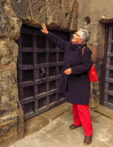 Guide Claudia Kuhnen stands outside the door to the cell where St. Simeon, Trier's patron saint, lived for seven years inside the Porta Nigra Roman gate. Copyright Amy Laughinghouse.