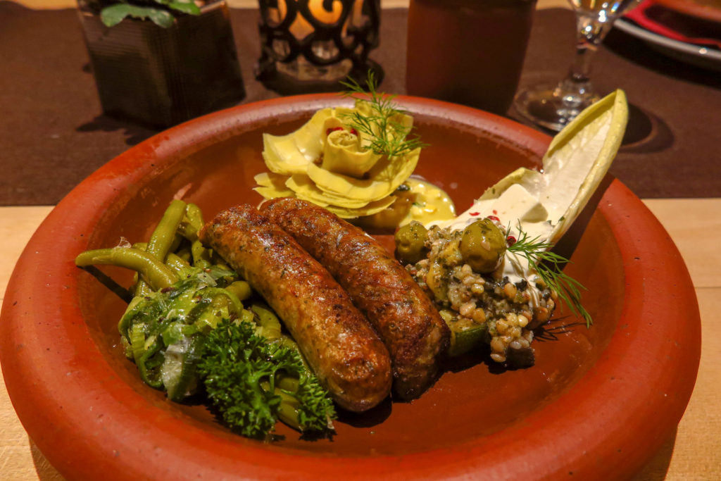 Sausages with green beans and fish sauce at Zum Domstein, prepared using 2,000-year-old Roman recipes. Copyright Amy Laughinghouse.