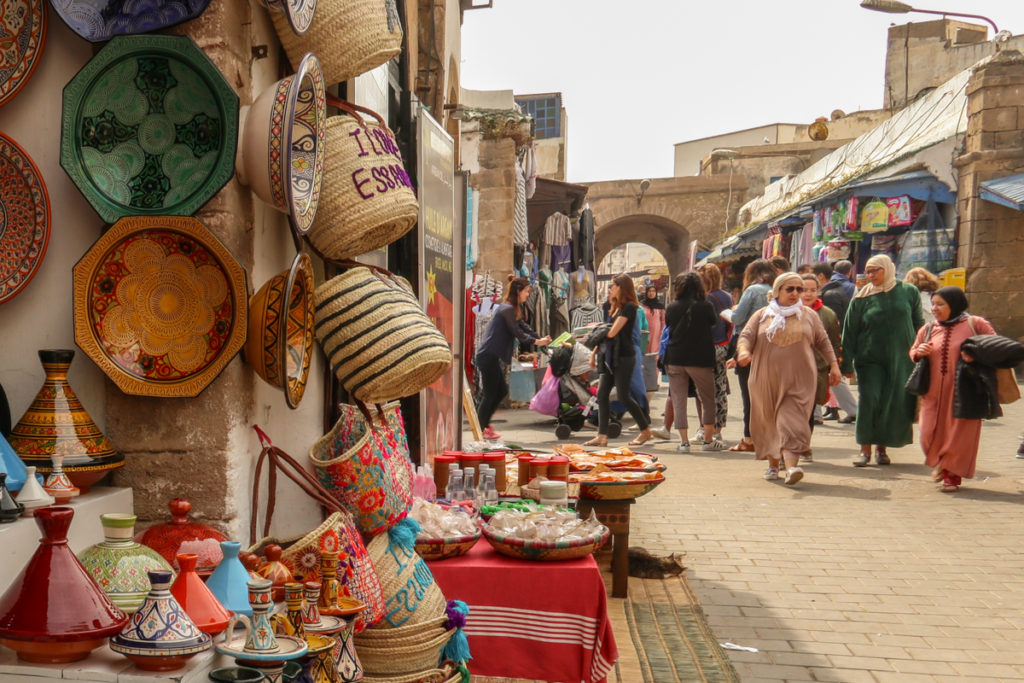 Historic Essaouira's main shopping street, which runs northeast to southwest through the heart of the medina, is frequented by locals and tourists alike. Copyright Amy Laughinghouse.
