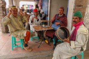 Musicians enjoy a pot of tea near Essaouira's spice market. Copyright Amy Laughinghouse.