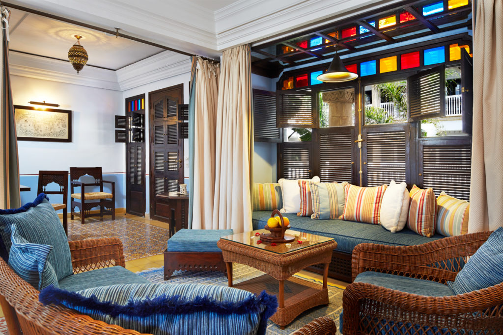 Tiled floors, louvered shutters and stained glass accents adorn a Portuguese-style premium suite at Heure Bleue Palais hotel in Essaouira. Courtesy Heure Bleue Palais.